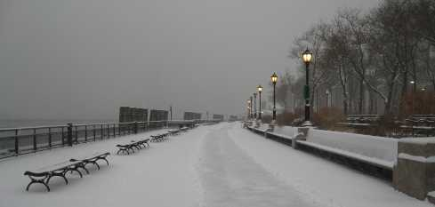 snowy battery park promenade looking west