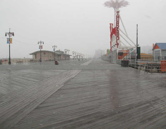 Snowy, wet Boardwalk at Coney Island.