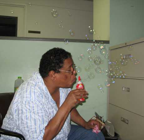 Uncle Sidney blowing bubbles in Alcove 1