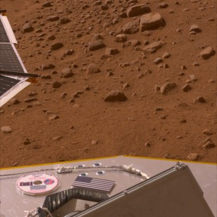 photograph of Martian surface with DVD and American flag